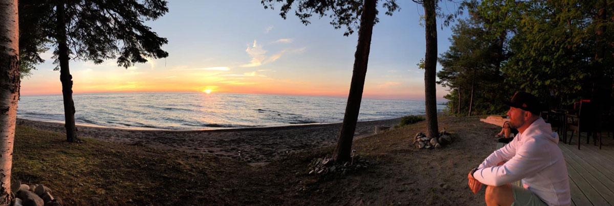 Mark on a beach at sunset